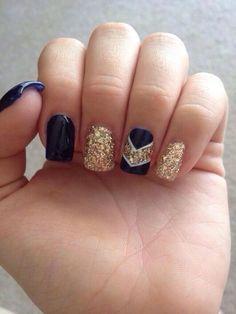 Dark Blue and Gold Glitter Chevron Nails.
