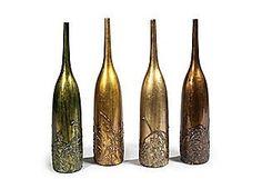 metallic wine bottles with leaf designs