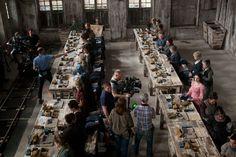 Les Mis (2012)   On the set of Jean Valjean's trinket factory. Anne Hathaway (Fantine) in the pink dress.