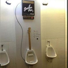 Guitar urinal for guys who want to make music as they pee