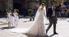Princess' dress The bride Claire Lademacher wore a stunning Elie Saab ivory silk gown fully embroidered in Chantilly lace with floral motifs and 10 feet train. Meanwhile the long veil, which gave life while she walked down the aisle, was also beaded with lace. Royal wedding of Prince Felix of Luxembourg