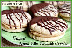 Dipped Peanut Butter Sandwich Cookies from Six Sisters' Stuff #recipe #dessert #cookieexchange
