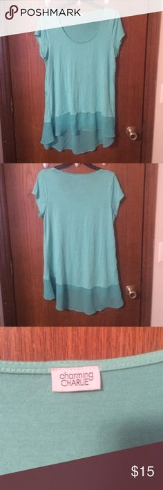 Turquoise blouse Beautiful turquoise blue short sleeved top with a flared bottom. Gently used and worn once or twice. Charming Charlie Tops Blouses