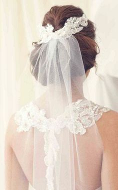 This veil is perfect with the design of the dress.  It accents it while still letting the detail show...