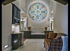 A former Catholic church in Cherry Creek North has been converted into a large luxuriously home priced at just under $2.3 million. Pews not included.  Featuring over 5,300 square feet, the home is made from red brick with several giant stained-glass windows set in 35-foot vaulted ceilings and a mezzanine for the master bedroom, bath and laundry room. Stained Glass Rose, Church Conversions, Fairytale House, Colorado Real Estate, Warehouse Conversion, Church Building, Home Photo, House Prices, My Dream Home