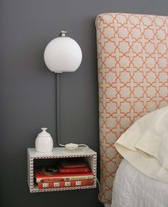 An easy DIY floating nightstand. This would definitely be great to reduce furniture clutter in a small Bedroom. I would leave off the nail heads and stain/paint it dark since I have light walls anf dark headboard. And it's cheap! Diy Nightstand, Floating Nightstand, Bedside Tables, Floating Wall, Floating Drawer, Floating Shelves, Floating Lights, Small Space Living, Small Spaces