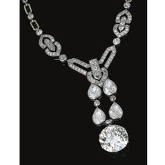 Diamond Necklace, Chaumet, circa 1915. -. The front millegrain-set with circular- and single-cut diamonds, suspending a fringe of pear-shaped stones terminating on a circular-cut diamond weighing 27.62 carats, length approximately 435mm, mounted in gold and platinum, unsigned, French assay and maker's marks. photo Sotheby's