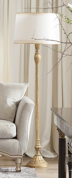 Emelio Floor Lamp by Ebanista. Hand-carved floor lamp with 22k antiqued gold detailing. Shown with Naples Floor Lamp Shade - Cream, sold separately. Discover more at ebanista.com.