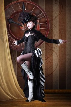 """The photo above shows a night circus performer in front of a clock. The fact that the circus is only open at night is supposed to represent the overall """"dark"""" nature of night. (explain with words)"""