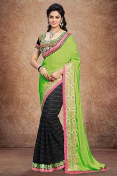 Parrot green black Crepe and net Saree With Art silk Blouse Parrot green, black crepe and net saree with black art silk blouse.  Embellished with embroidered, resham, zari and stone.  Saree comes with asymmetrical neck blouse.  Product are available in 34,36 sizes. It is perfect for festival wear, party wear and wedding wear. http://www.andaazfashion.com.my/womens/sarees/partywear