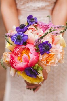 colorful bouquet. photo by white rabbit studios #peonybouquet  #weddingchicks  http://www.weddingchicks.com/2014/01/05/sloss-furnace-wedding/