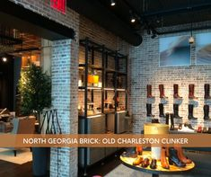 Boot season is here 👢 , and this stylish shoe store has us yearning for a new pair. Don't you love how they displayed them against brick clad walls that feature our Old Charleston Clinker? #boots #bootseason #brickwall #interiorinspiration #northgeorgiabrick