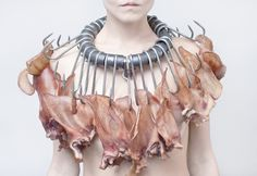"""Okay, I promised myself I wouldn't post gross-out artist-statement studio jewellery, but I might as well do it once as an illustration. Meat (dried pigs' ears) and butcher's hooks. """"Fleischerhaken Collier"""" (Meathook Necklace) by Siegfried Büehler from his """"Unwearable/Unbearable"""" series - photo by Alexander Mainusch. Right, that's it for the statement necklaces."""