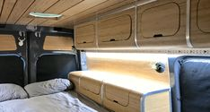 Sprintervan Camper Kit, bamboo overhead and bedside cabinets.