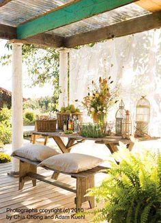 Notice the wispy curtains. I love how they make you just want to sit down and enjoy this wonderful outdoor space. The pretty summer flowers and basket of apples oh so nice