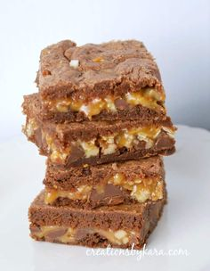 Caramel Brownies . . . gooey caramel sandwiched between layers of chocolatey brownies. Does it get any better? A must try brownie recipe!