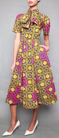 NEW The Michelle O' Midi Dress. Collared Shirtdress w/ Elastic Waist Full Flare Skirt 100% Cotton Dress. Long or Short Sleeve. Hidden front snap closures. Detachable Pussy Bow Necktie. Full flare skirt w/ pockets. Pull over dress. Ankara | Dutch wax | Kente | Kitenge | Dashiki | African print dress | African fashion | African women dresses | African prints | Nigerian style | Ghanaian fashion | Senegal fashion | Kenya fashion | Nigerian fashion | Ankara crop top (affiliate)