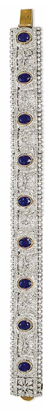 A SET OF SAPPHIRE AND DIAMOND JEWELLERY   The necklace designed as a diamond-set openwork band with foliate motifs, enhanced with oval-shaped collet-set sapphires, a bracelet, a pair of ear clips and a ring en suite, mounted in gold [Bracelet only]