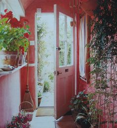 Lovely Hall Way...pink paint and plants.