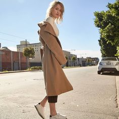 Making our way downtown because we're party bound in our signature wool coat.    #jinglimited