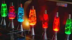 An interesting trend in molecular mixology today is the 'lava lamp cocktail'. A lava lamp is a decorative lamp in which multicoloured globules of wax are placed in a glass vessel that move round inside depending on the heat inside the lamp. Cool Lava Lamps, Club Lighting, Lampe Decoration, Decorations, Edison Lamp, Led Lamp, Large Lamps, Contemporary Lamps, Decorating Tools