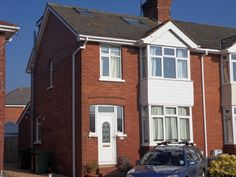 Semi Detached House – hip to brick gable with flat roof dormer Exeter, Semi Detached, Detached House, New Staircase, Brick Construction, Dark House, Roof Window, Attic Design, Gable Roof