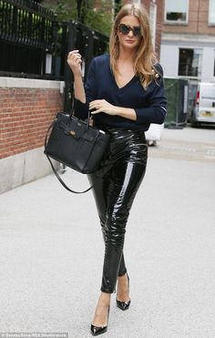 The former Made In Chelsea star, 28, commanded attention in striking PVC trousers as she headed out in the city - flashing the dazzling diamond for all to see.