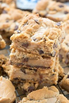 Gooey Peanut Butter Chocolate Chip Cookie Bars - An easy chocolate chip cookie bar stuffed with a gooey peanut butter mixture. This is such an easy recipe! | Posted By: DebbieNet.com