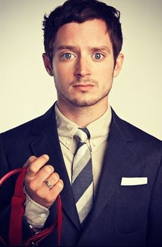 He looks like he's asking someone which tie he should wear // Elijah Wood