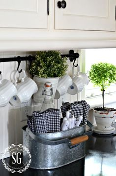 FARMHOUSE KITCHEN -white coffee cups and galvanized caddy for utensils and napkins