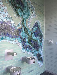 Embrace Unique Colors Collaborating with the architects and City Representatives for this fine community mosaic, we developed an expansive blue palette illustrating this body of water and all its depths to be marveled. Visitors coming for hydration can learn more about wide variance of depths in their city's lake before returning to the walking trail.