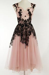 This ultra-pretty 1950s party dress is pale pink with a net skirt but is spiced up with black floral lace and diamante.