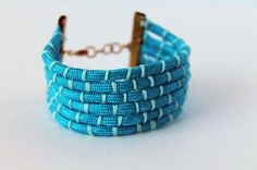 Woven cuff tutorial. Made with embroidery floss, but could be made with microcord or nanocord as well