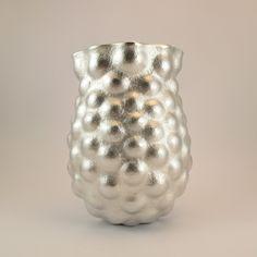 Hannah Felicity Dunne 05 Title: Bulbous Vase Year: 2011 Caption: Britannia silver, Hand-raised and chased, Diameter 9cm Height 13cm  Photographer: Hannah Dunne  Website: www.hannahfelicitydunne.co.uk
