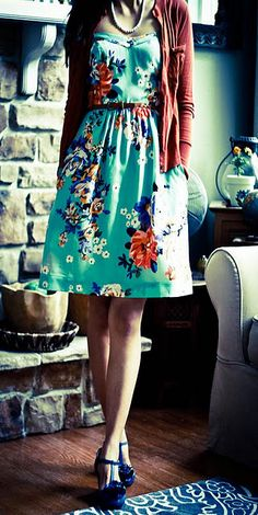 Love this dress. Love the green, love the floral that somehow wavers between a couch and an oriental screen, and love the shoes. *le sigh*