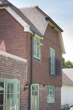 PERFORMANCE triple glazed  timber windows with interstitial glazing bars at Sussex low energy retrofit: PERFORMANCE triple glazed  timber windows with interstitial glazing bars at Sussex low energy retrofit.