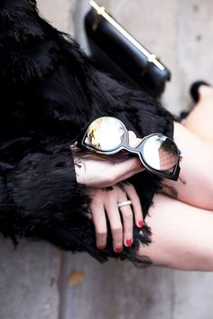 Blair Eadie wears a fur coat with mirrored sunglasses and a top-handle bag
