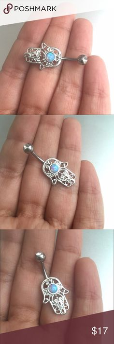 Light Blue Opal Belly Button Ring Hamsa Navel Bar Last one in this color! Lovely light blue opal on a hand of Fatima setting. The barbell is 14 gauge, 11mm, surgical steel. More colors available in my shop. You will receive a new, unworn item. Jewelry