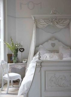 French style in all white has a shabby chic elegance. This dreamy bedroom design is full of French details in the furnishings and linens.