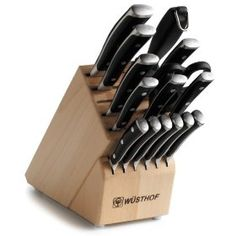 Wusthof knives with a wooden block. These are the sharpest and best knives ever! I want a Santoku for sure.  Empty slots allow you to mix and match. ***TOP OF MY LIST***
