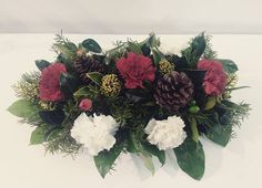 awesome vancouver florist A simple christmas centerpiece to kickstart all your holiday dinner's.  #christmas #tistheseason #merrychristmas #burnabyflorist #amazingflorals by @amazingflorals  #vancouverflorist #vancouverflorist #vancouverwedding #vancouverweddingdosanddonts