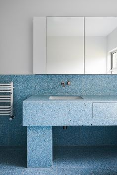 The Northcote House project by Winwood Mckenzie Architecture reworks the existing interior spaces to transform the existing residence into a light filled, functional family home. A dramatic tiled terrazzo bathroom references the history of the post-war cream brick home.