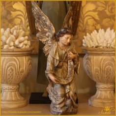 Italian angel on hand built console table and hand painted canvas...at Swede
