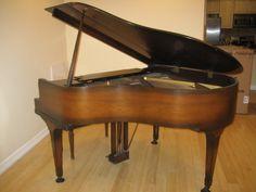 Antique Pianos: Wurlitzer Baby Grand Piano, baby grand piano, mahogany color