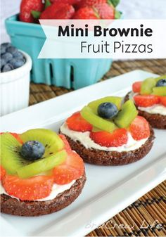 Top delicious chocolate brownies with a cream cheese frosting and your favorite fruit for a delicious dessert recipe your family will love—Mini Brownie Fruit Pizzas.