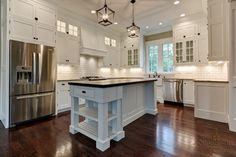 love the kitchen island pendant lights BUT not the white cabinets. They show all the dirt.