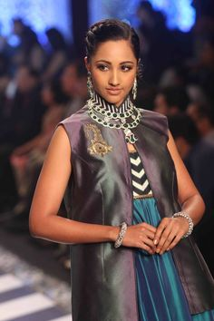A model walks the ramp of the Indian International Jewellery Week