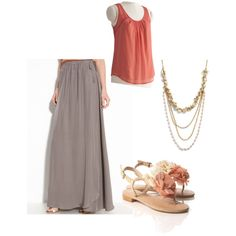 I love the long skirt look. Flowery sandals and a multi-chain necklace make this simple outfit more interesting.