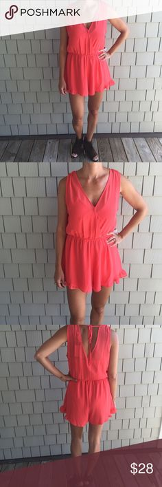 """ASTR Coral Ruffle Hem Romper NWT Ruffle hem Romper (Ruffle is at the side of the bottom hem) in a beautiful bright shade of coral.  Pull on style with a v-neck neckline and button closure at the chest.  Fully lined and a back tie detail.  Pair with wedges or sandals could add a blazer or Jean jacket.  Or pair with cowboys for any up coming country music concert.  Inseam measures ~2.75"""" chest measures ~19.5"""" armpit to armpit & length measures ~31"""".  Has and elastic waist band.  Don't forget…"""