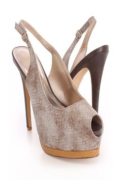 Add glamour and sparkle to any outfit with these sexy platform heels! They are perfect for dancing the night away or just a day out with the girls. They will look super hot paired with your favorite skinnies or dress. Make sure you add these to your closet, it definitely is a must have! Featuring faux snake leather, buckle closure slingback, stack colored contrast platform, peep toes.Insole with faux leather lining, lightly cushion foot-bed, out-sole with rubber traction. Approx 6 inch heels…